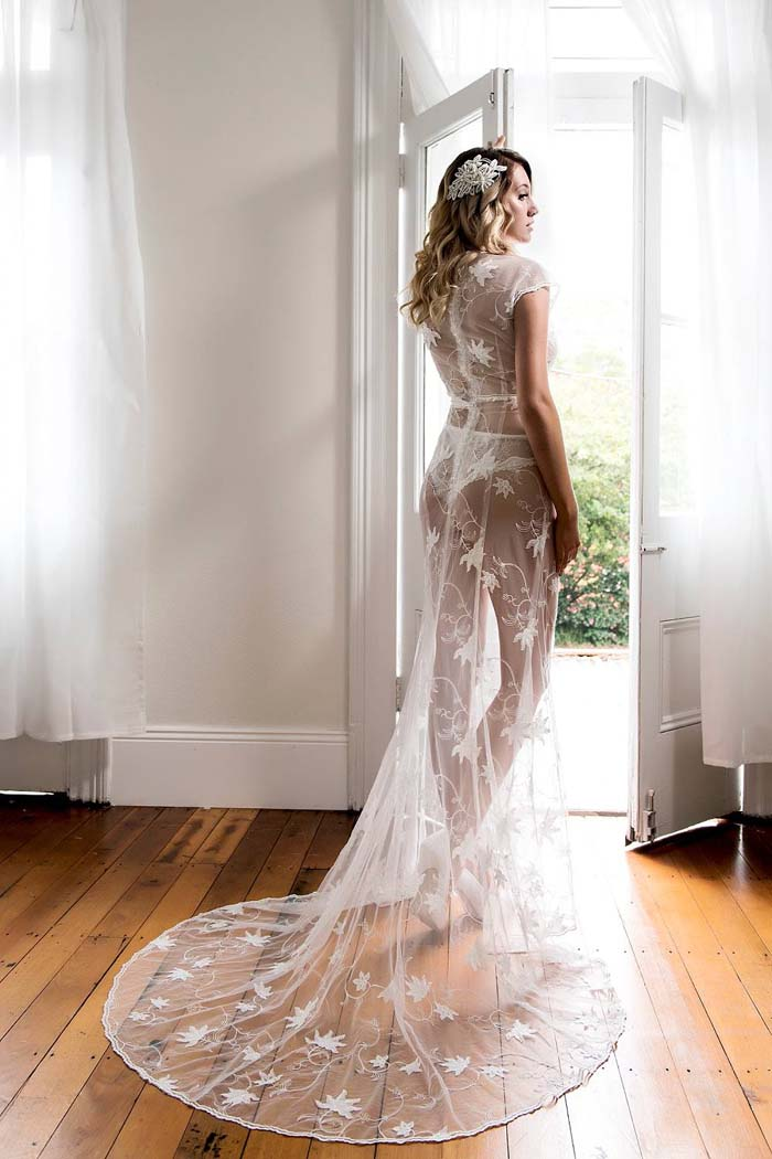 Peter Trends lace sheath wedding dress in boudoir photo shoot.