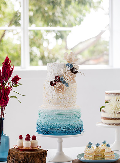 Wedding cakes archives modern wedding traditionally wedding cakes were seen as a symbol of happiness prosperity and fertility these days the cutting of the cake is still held as an important junglespirit Choice Image