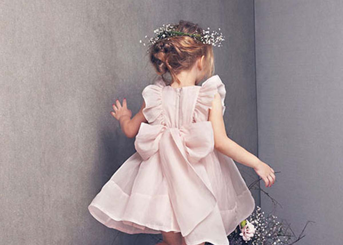 d235232473b 35 Unbelievably Cute Flower Girl Dresses for a Spring Wedding - Modern  Wedding