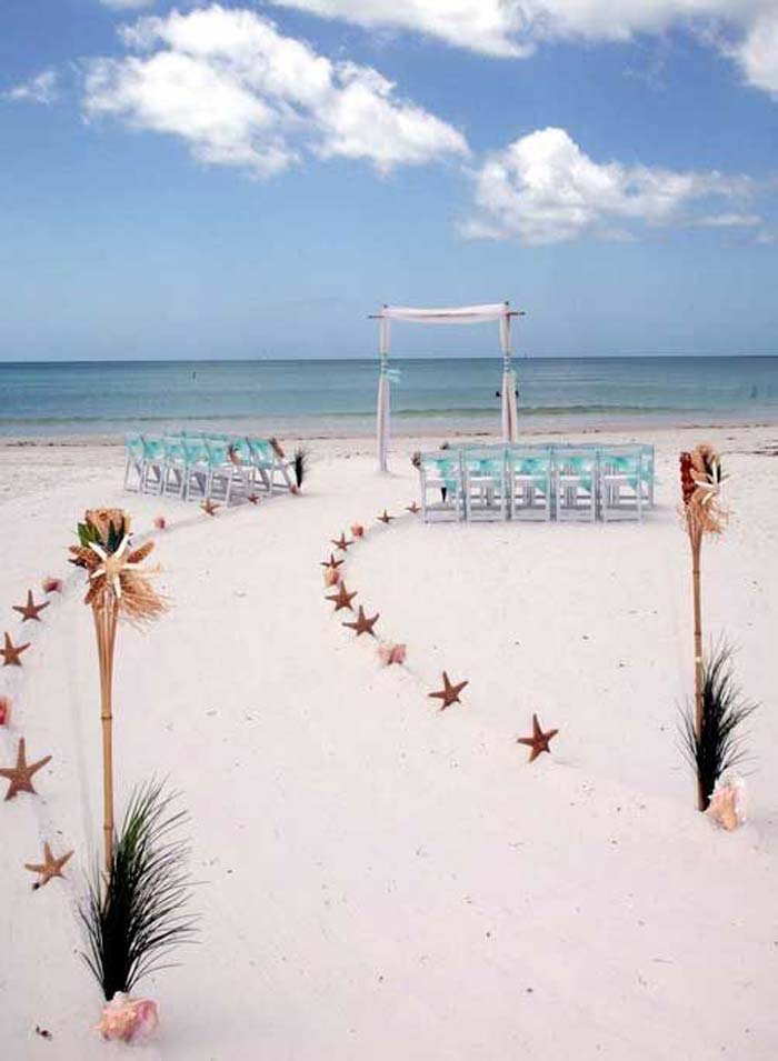 starfish markers to style wedding aisle