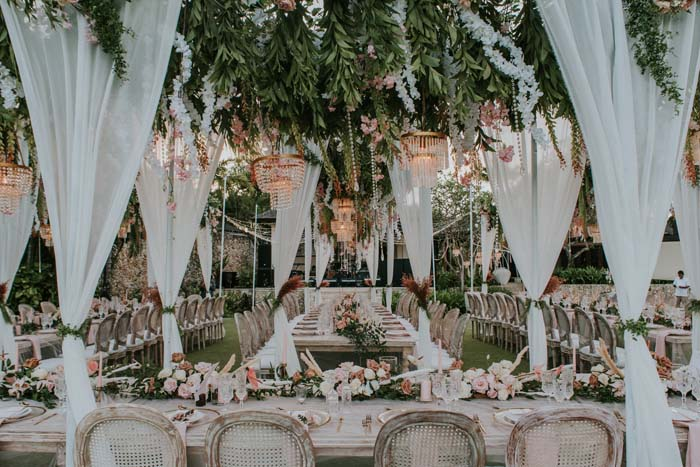 wedding reception with chandeliers and drapery